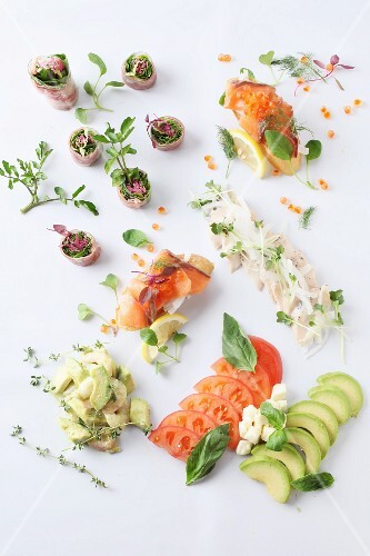 Various canapés with salmon, vegetables and herbs