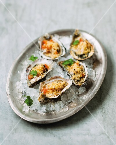 Oysters with a tomato and shallot dressing and chilli breadcrumbs
