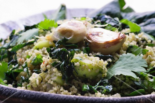 Quinoa salad with spring onions, grilled garlic, celery, coriander, parsley and herbs