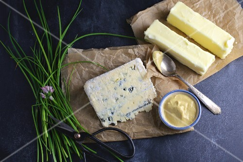 An arrangement of butter, blue cheese and chives