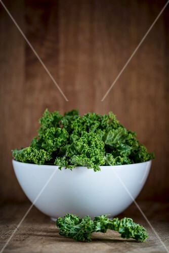 Fresh kale in a porcelain bowl