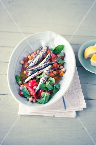 Anchovies with a chickpea medley and mint