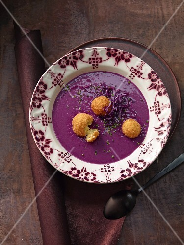 Foamy red cabbage soup with crispy baked sheep's cheese balls