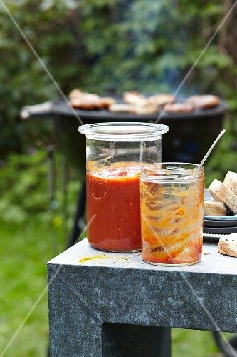 Homemade curry sausage sauce for a barbecue party on a table outside