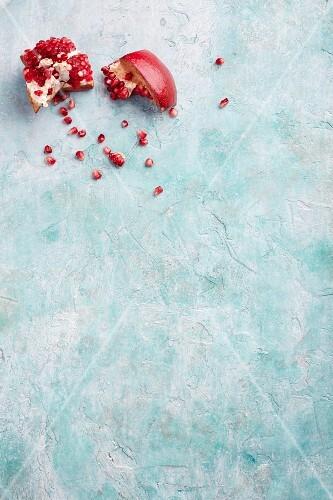 A broken pomegranate on a blue surface