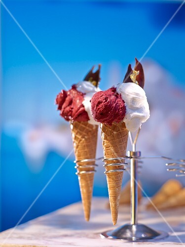 Two types of ice cream in cones in a cone holder