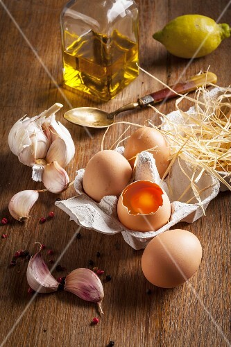 Ingredients for aioli: eggs, garlic and olive oil