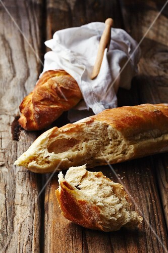 Baguettes on a wooden surface
