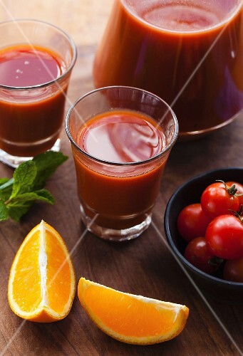 Tomato and orange juice with ingredients