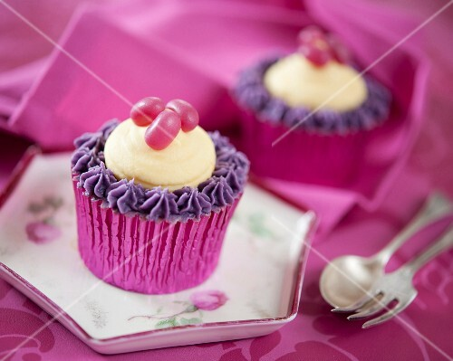 Cupcakes decorated with jelly beans, purple icing and vanilla butter cream