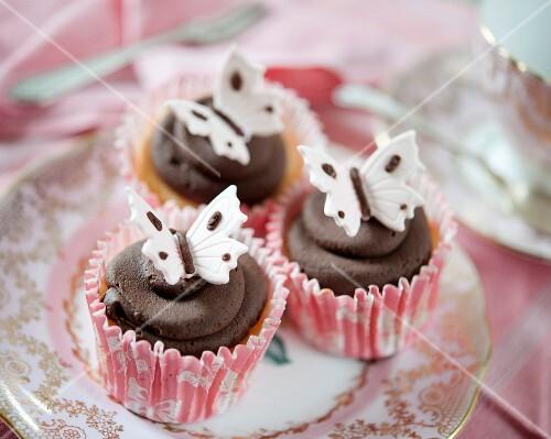 Dark chocolate cupcakes with fondant butterflies