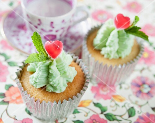 Cupcakes with mint icing and heart-shaped sweets