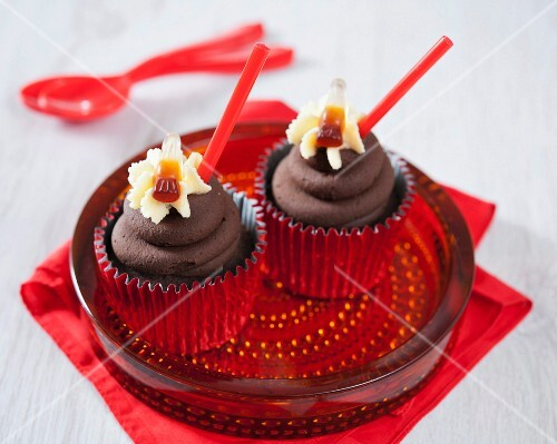 Chocolate cupcakes with cola and cola bottle sweets