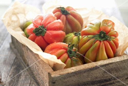 Beefsteak tomatoes in a crate