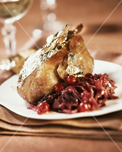 Roast quail with gold leaf and red cabbage