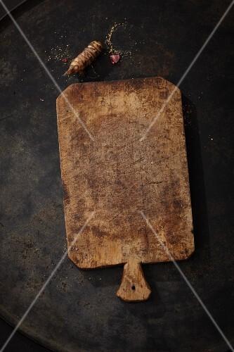 Jerusalem artichokes and an old chopping board