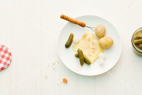 Raclette with potatoes and gherkins