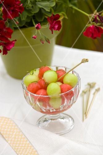Various mellon balls in a glass bowl