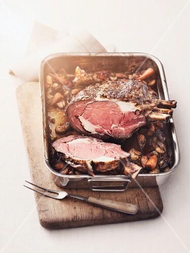 A whole roasted rack of ox, sliced