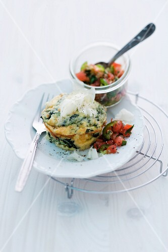 A frittata muffin with spinach and a vegetable dip