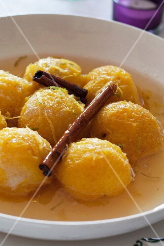 Candied yellow plums in a spicy broth