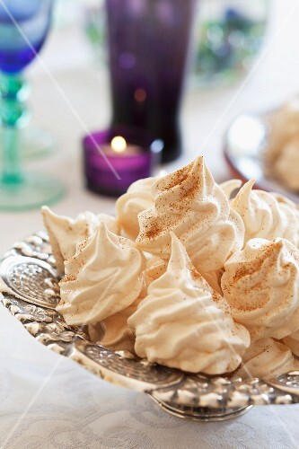 Cinnamon meringues on a silver stand