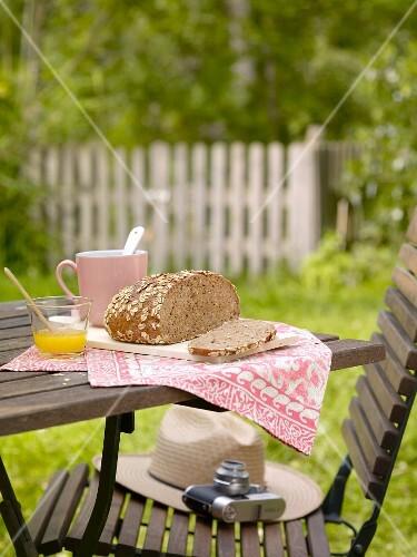 Wholemeal bread, sliced, on a garden table