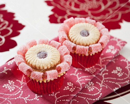 Cupcakes decorated with jam sandwich biscuits and jelly sweets