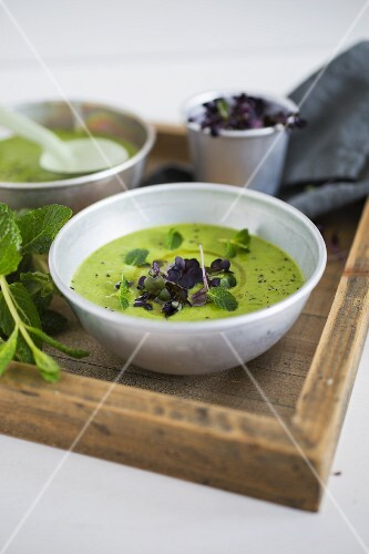 Pea and coconut soup with mint and daikon radishes