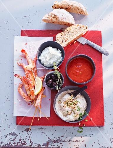 Prawn skewers, vegetable baguette and three different dips (Spain)