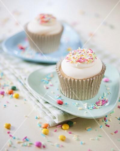 Vanilla cupcakes with coloured sugar sprinkles