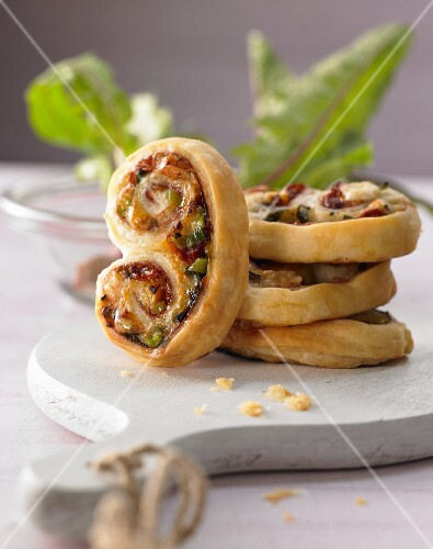 Baked ham pastries with mountain cheese and dandelions