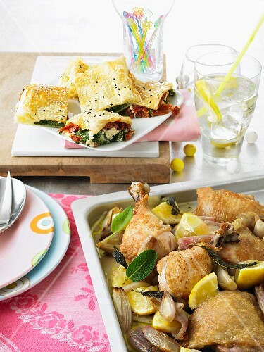 Stuffed puff pastries and lemon chicken on a roasting tin