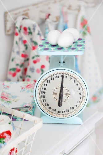 Eggs on pale blue, vintage kitchen scales