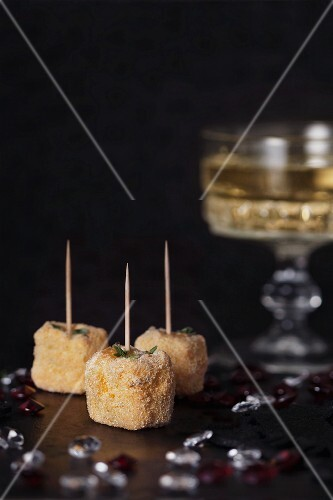 Polenta cubes with toothpicks