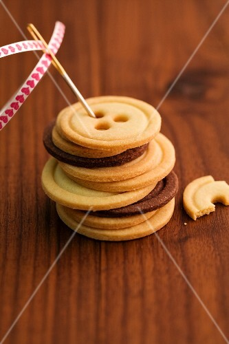 A stack of light and dark button biscuits