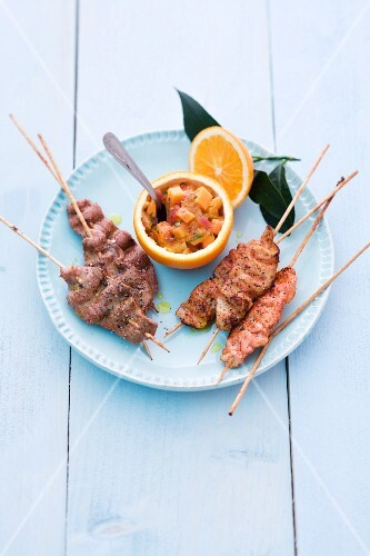 Papaya and orange chutney with chicken and veal skewers