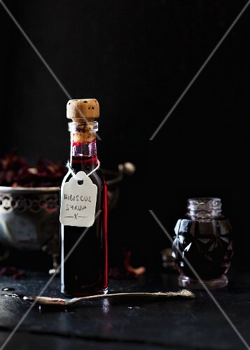Hibiscus syrup in a glass bottle