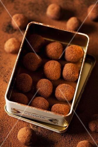Chocolate truffles in a metal tin