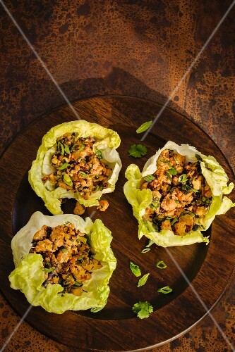 Laab Gai with chicken served in lettuce leaves (warm Thai salad)