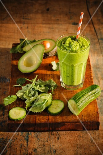 A green smoothie with almond milk, cucumber, avocado and kohlrabi leaves