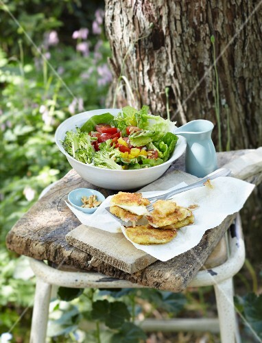Broccoli and tomato salad with mozzarella and pine nuts