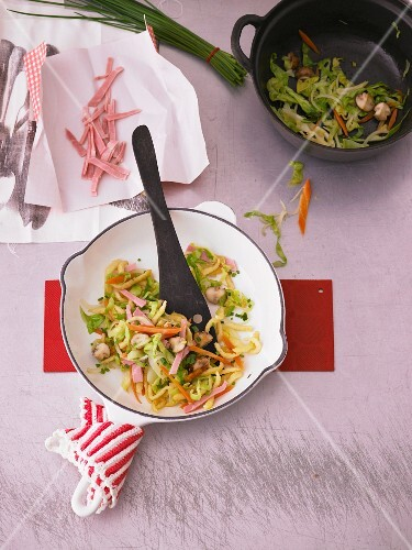 Fried Spätzle (soft egg noodles from Swabia) with pointed cabbage