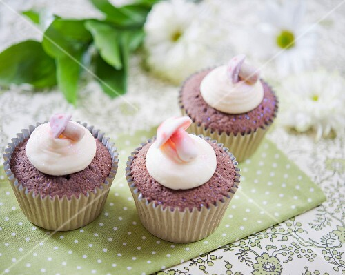 Chocolate cupcakes decorated with mushroom sweets
