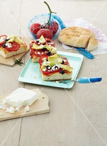 Bread pizzas with artichoke hearts
