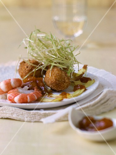 Fish meatballs and prawns with leek straw and pumpkin chutney