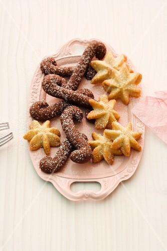 Various spiced Christmas biscuits on a serving platter