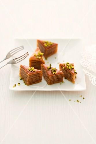 Baumkuchen (German layer cake) slices with pistachios