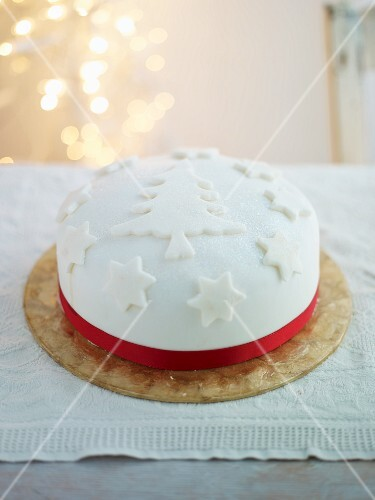 A festive Christmas Cake decorated with white fondant icing