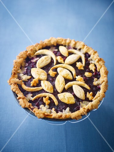 Blueberry tart with puff pastry decorations